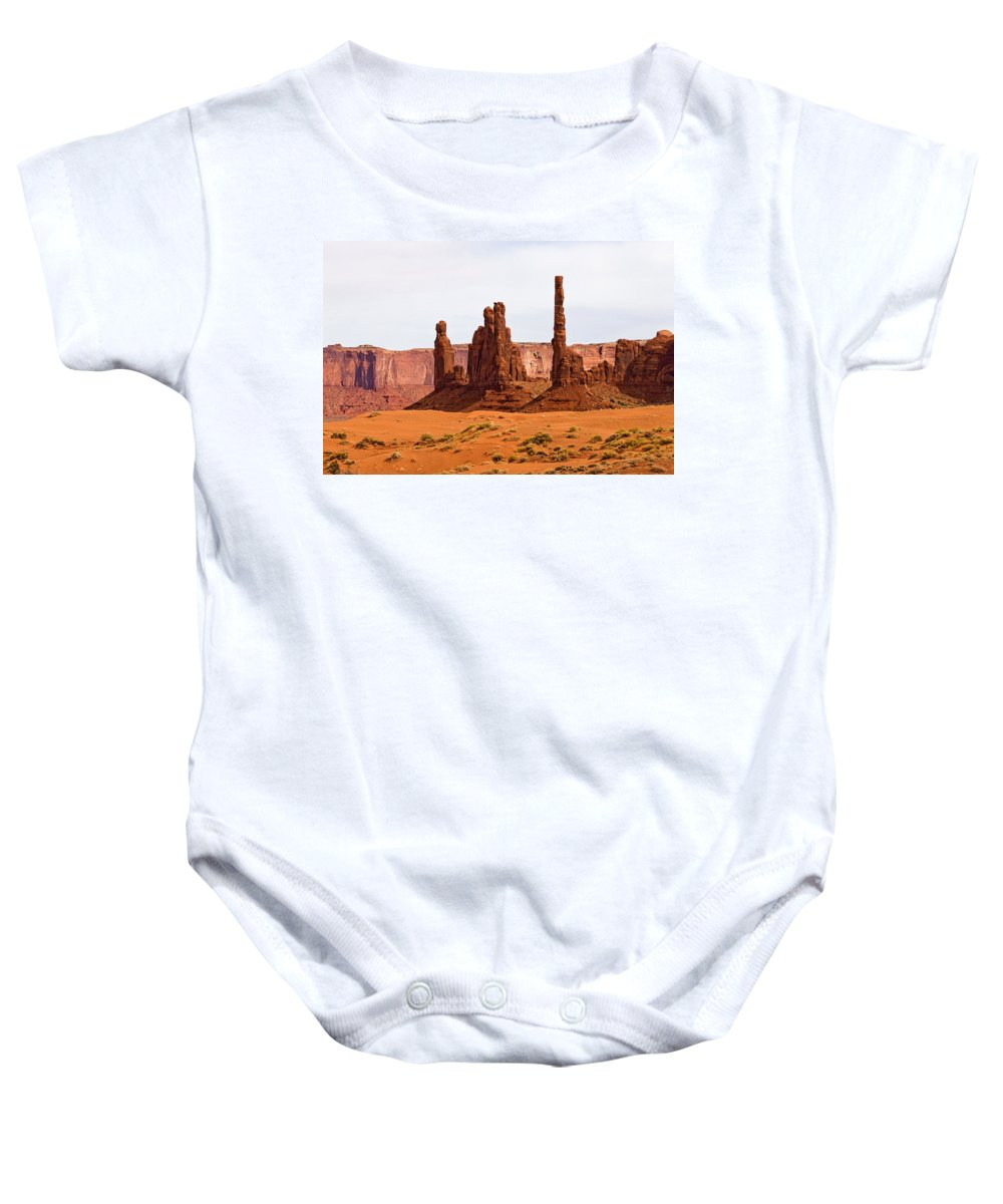 Monument Valley Baby Onesie featuring the photograph Totem Pole Buttes by Peter Tellone