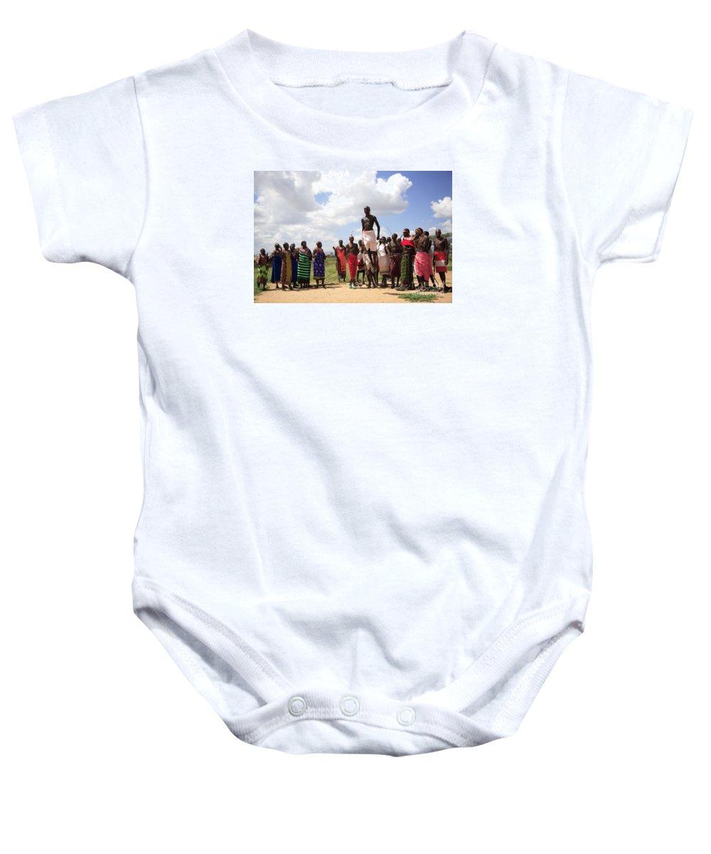 Africa Baby Onesie featuring the photograph Traditional Samburu Dance by Deborah Benbrook
