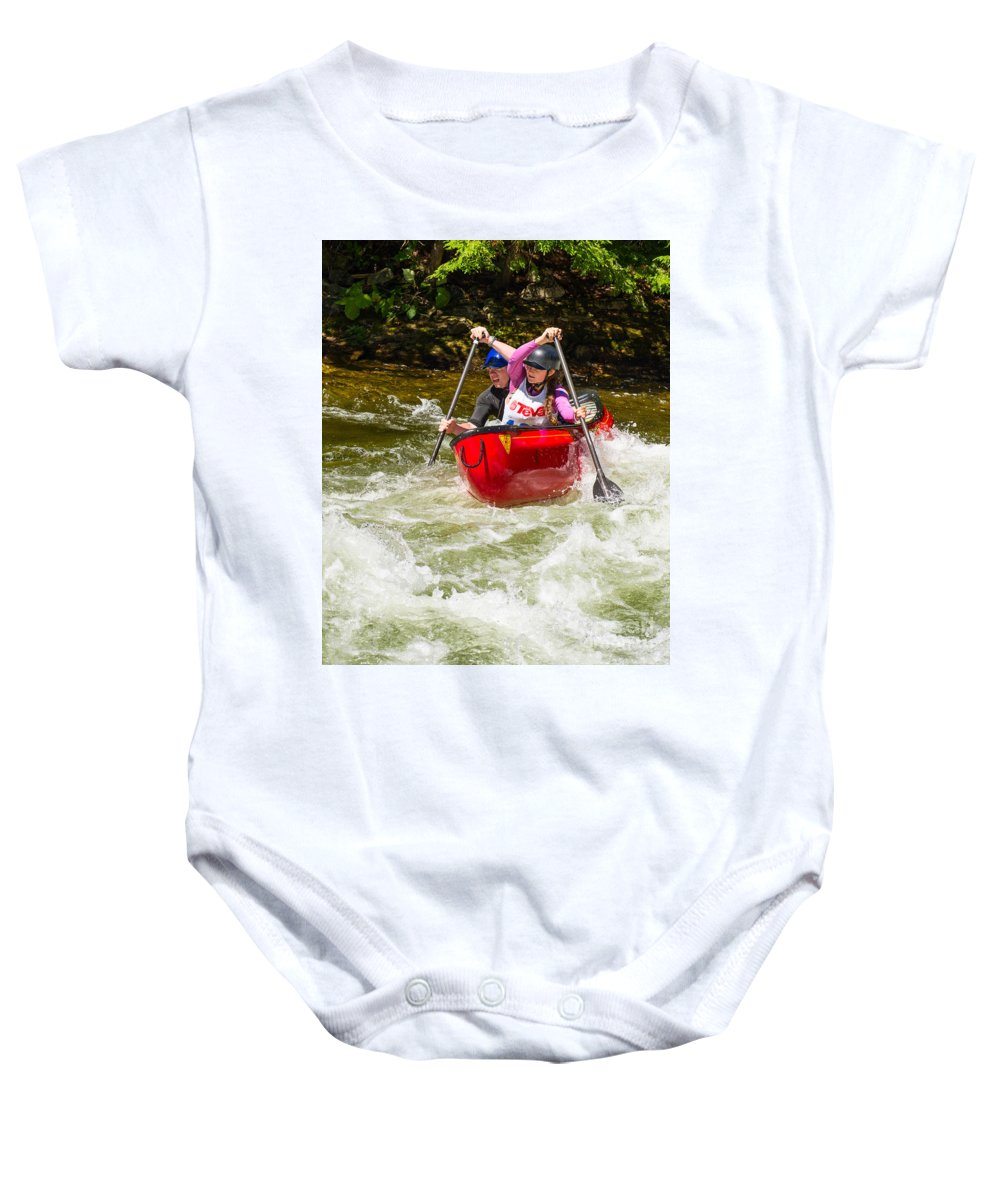 Canoe Baby Onesie featuring the photograph Two Paddlers In A Whitewater Canoe Making A Turn by Les Palenik