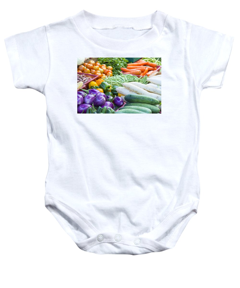 Vegetable Baby Onesie featuring the photograph Vegetables Stand In Wet Market by Jit Lim