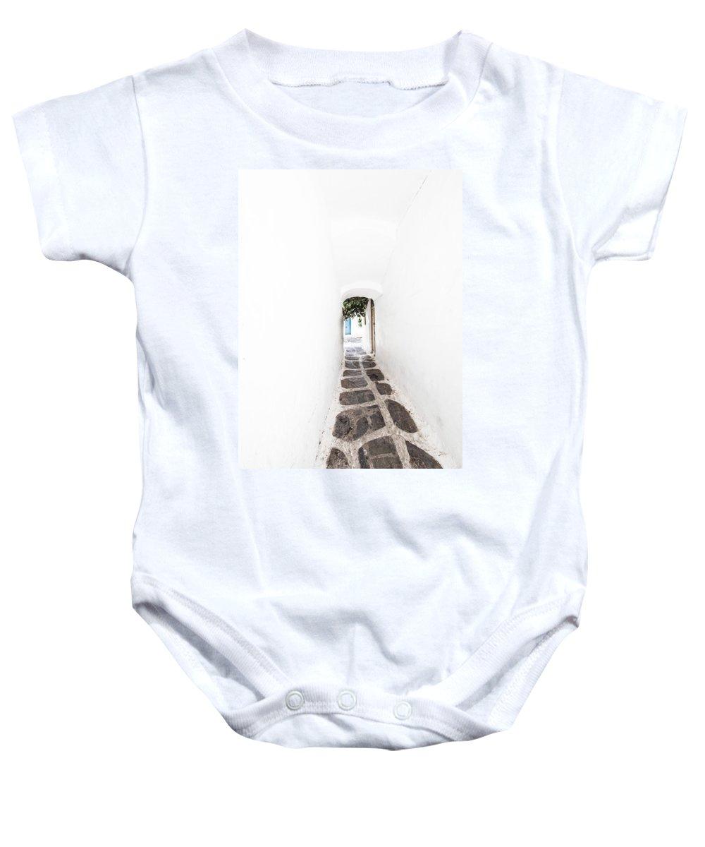 Mykonos Baby Onesie featuring the photograph White Mykonian Corridor by Hakon Soreide