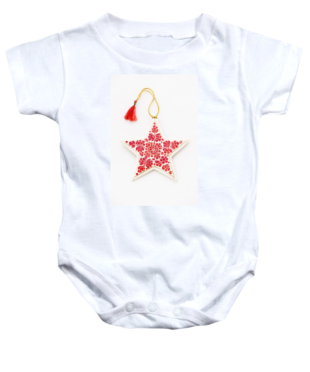 Background Baby Onesie featuring the photograph White Star by Anne Gilbert