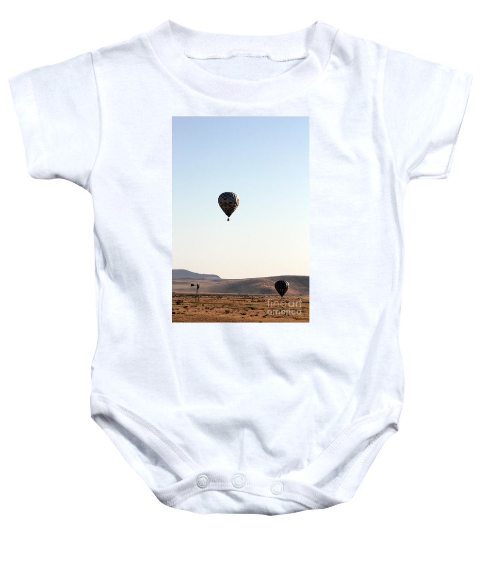 Windmill Baby Onesie featuring the photograph Windmill Ballooning by Alycia Christine