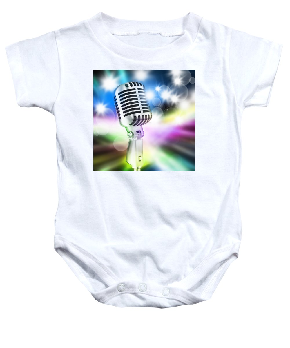 Audience Baby Onesie featuring the photograph Microphone On Stage by Setsiri Silapasuwanchai