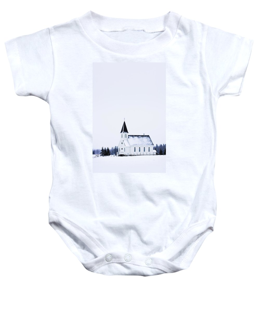 Ice Baby Onesie featuring the photograph Old Fashioned Steeple Church In Winter by Corey Hochachka