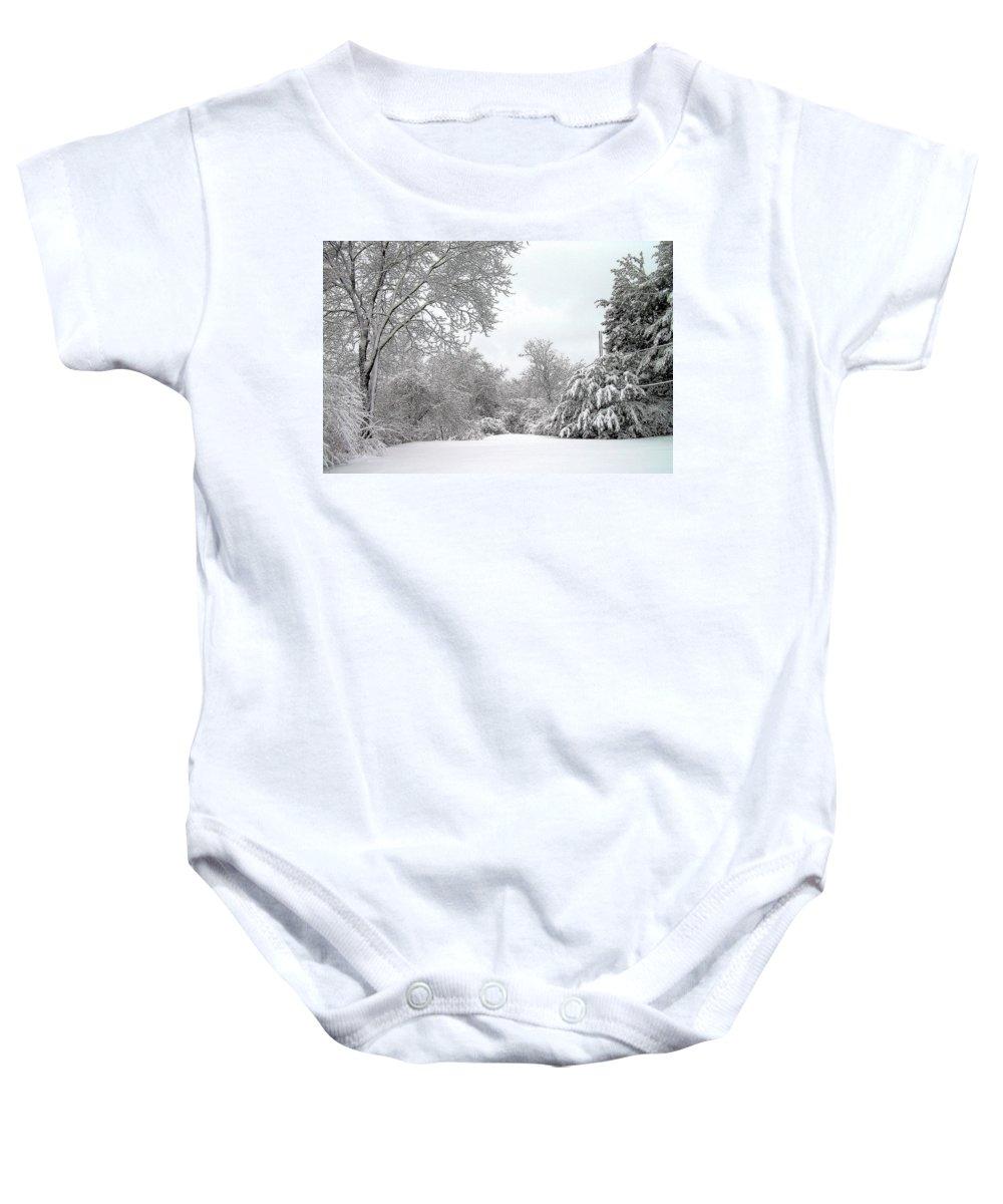 Snow Baby Onesie featuring the photograph Still by Jeff Heimlich