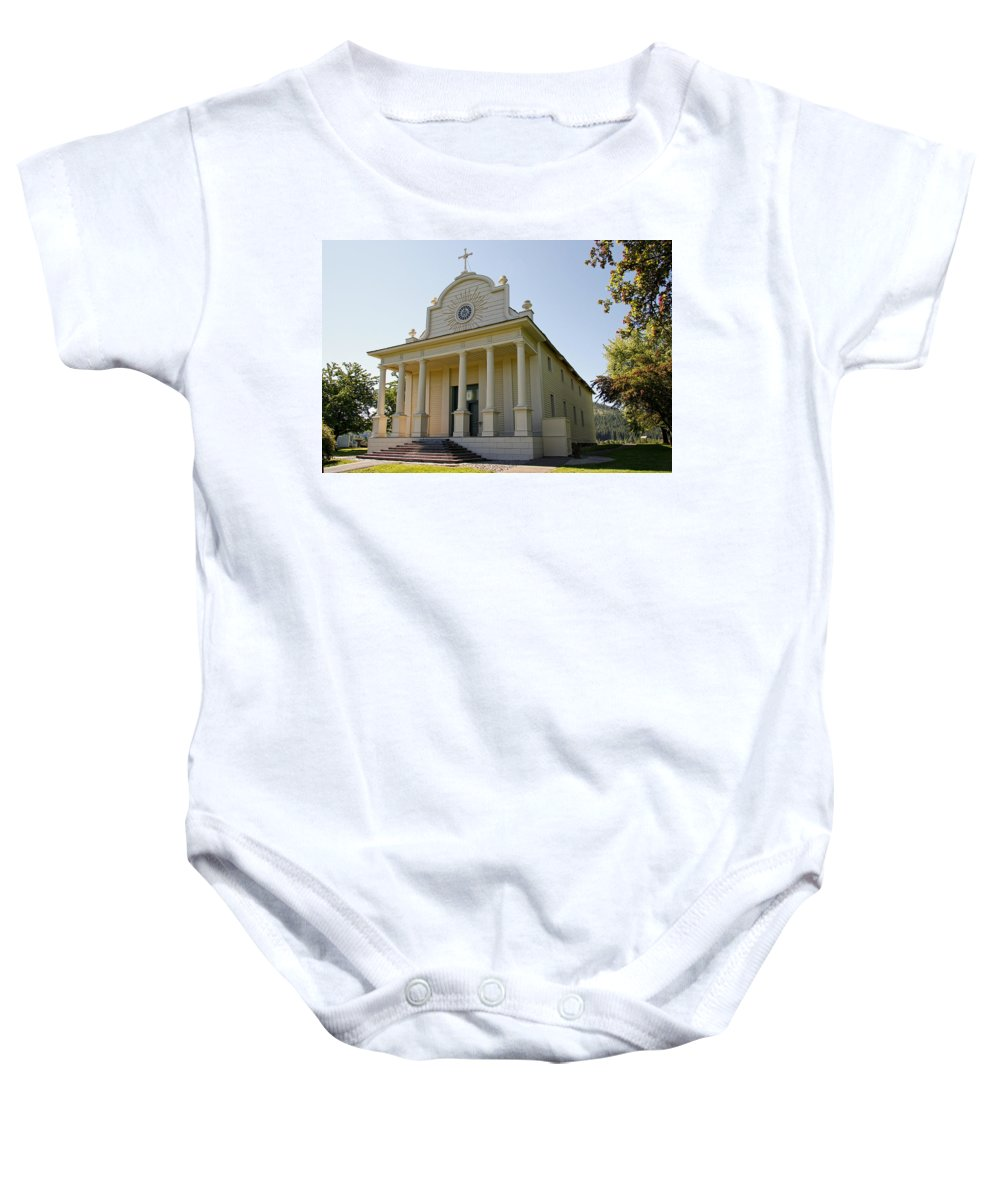 Cataldo Baby Onesie featuring the photograph 1840s Cataldo Mission - Idaho State by Daniel Hagerman