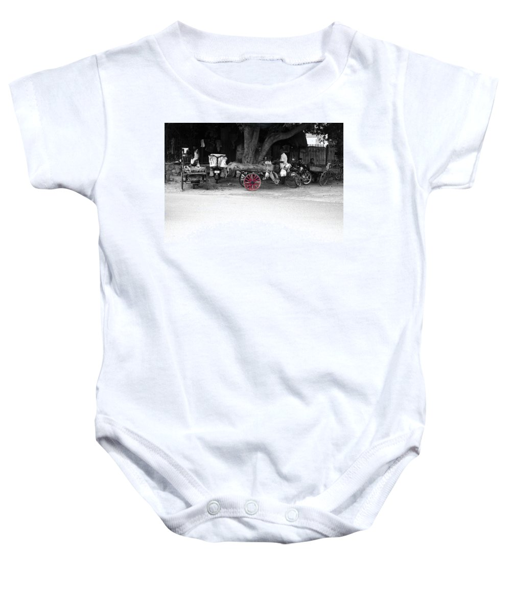 Hawker Baby Onesie featuring the photograph A Hawker On The Street by Sumit Mehndiratta