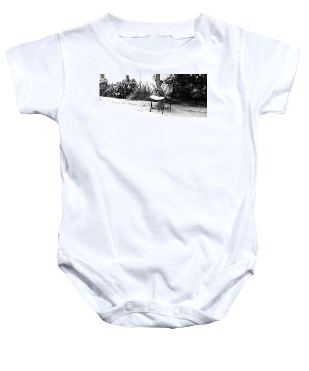Monochromatic Baby Onesie featuring the photograph A Torn Chair by Sumit Mehndiratta