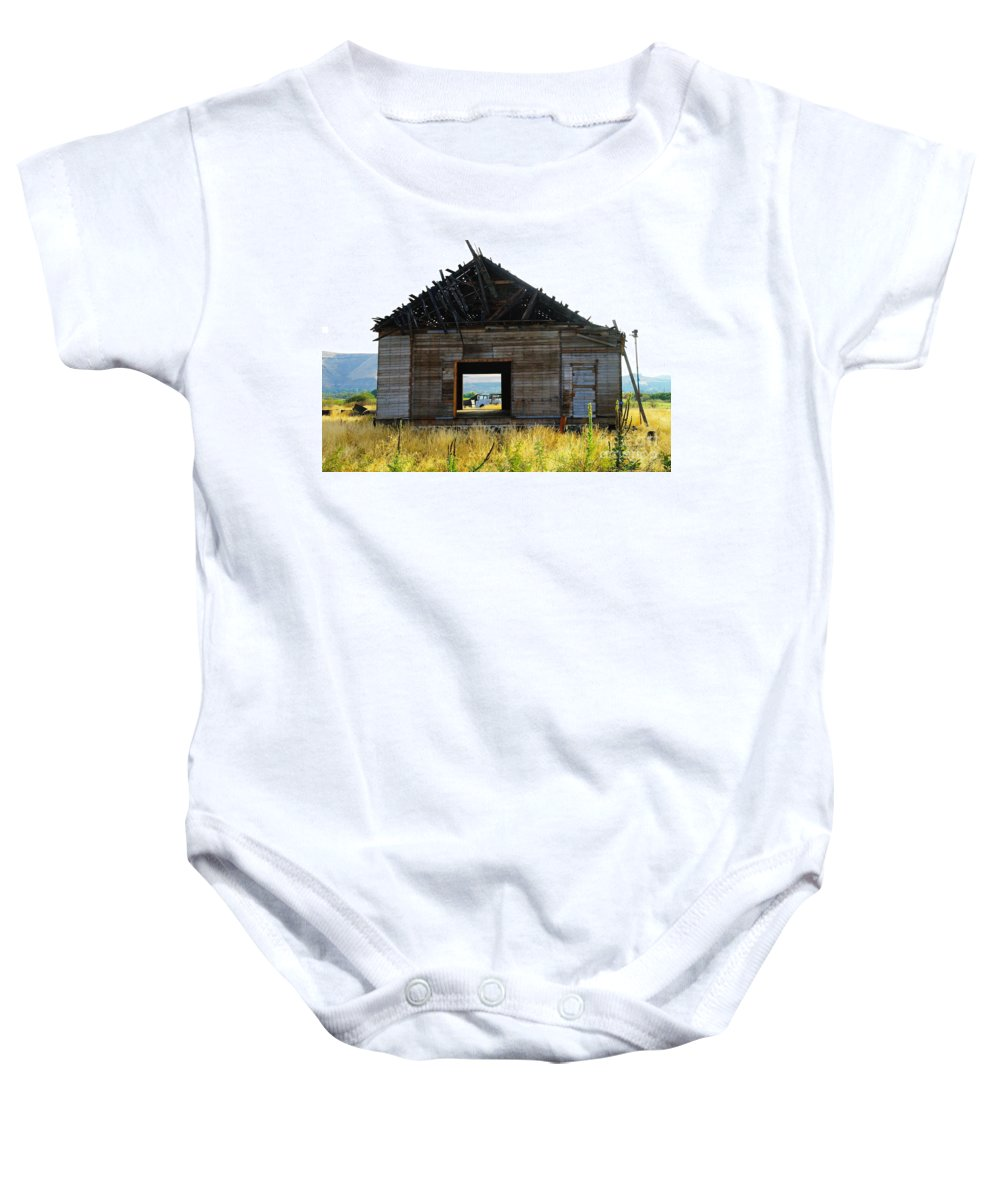 Barns Baby Onesie featuring the photograph An Empty Barn by Jeff Swan