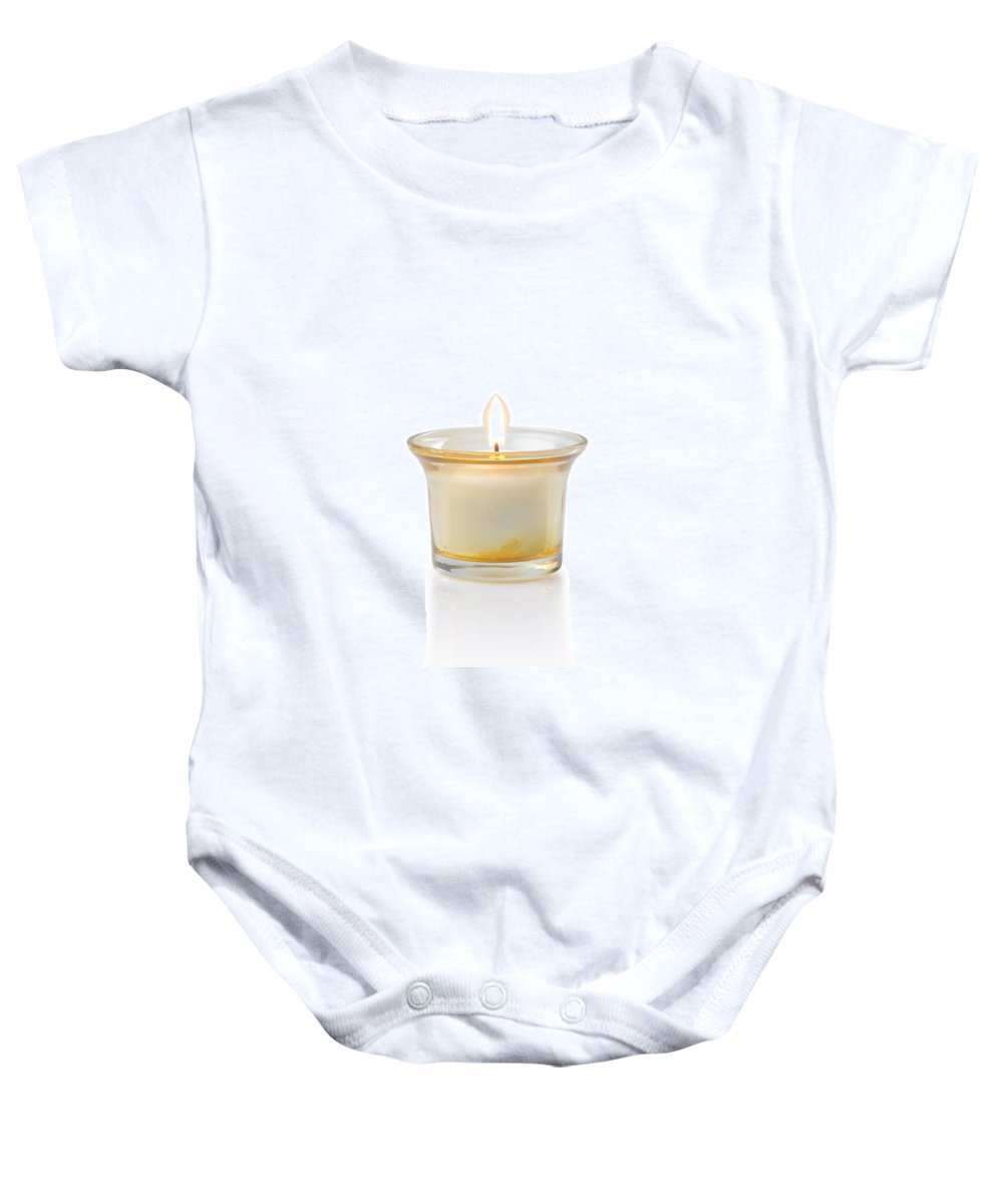 Candle Baby Onesie featuring the photograph Burning Candle by Atiketta Sangasaeng