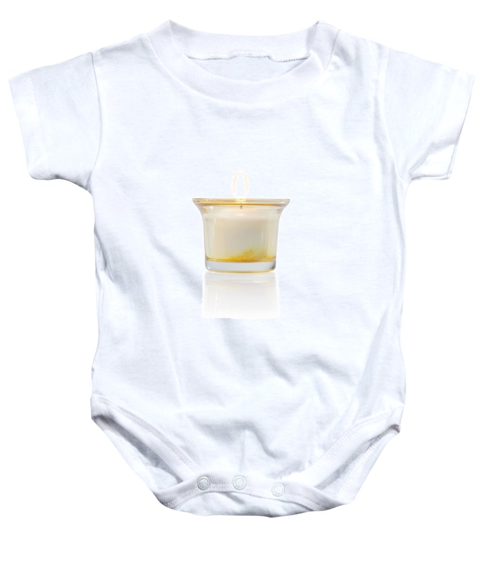 Candle Baby Onesie featuring the photograph Burning Candle In Glass Holder by Atiketta Sangasaeng