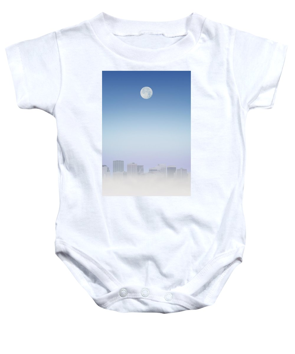 Business Baby Onesie featuring the photograph Moon Over Buildings by Kelly Redinger