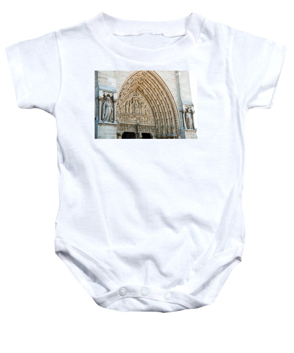 France Baby Onesie featuring the photograph Notre Dame Cathedral Right Entry Door by Jon Berghoff
