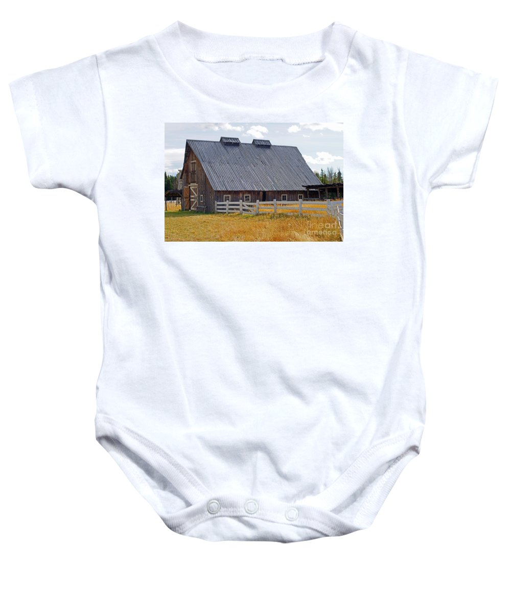 Old Barn Baby Onesie featuring the photograph Old Barn And Fence by Randy Harris