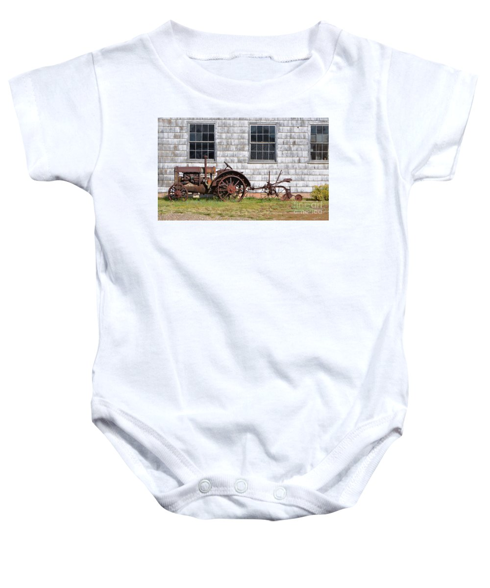 Fine Art Baby Onesie featuring the photograph Old Farm Equipment by Donna Greene