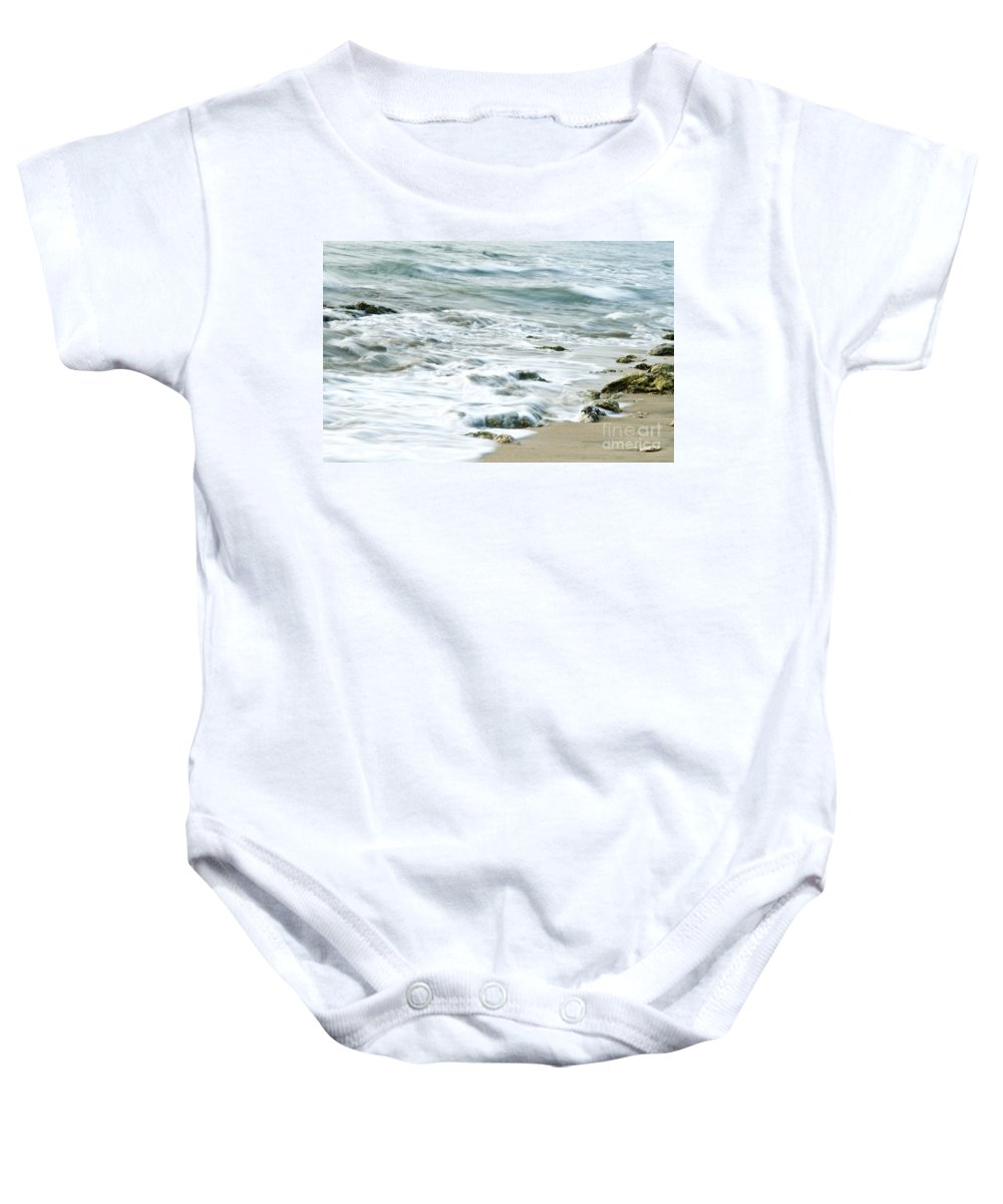 Sea Baby Onesie featuring the photograph Rushing In by Charuhas Images