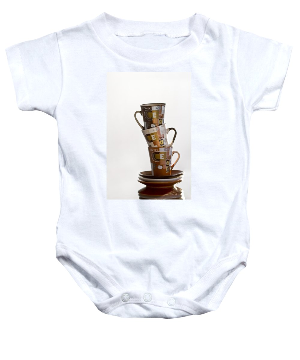 Cup Baby Onesie featuring the photograph Stack Them Up by Evelina Kremsdorf