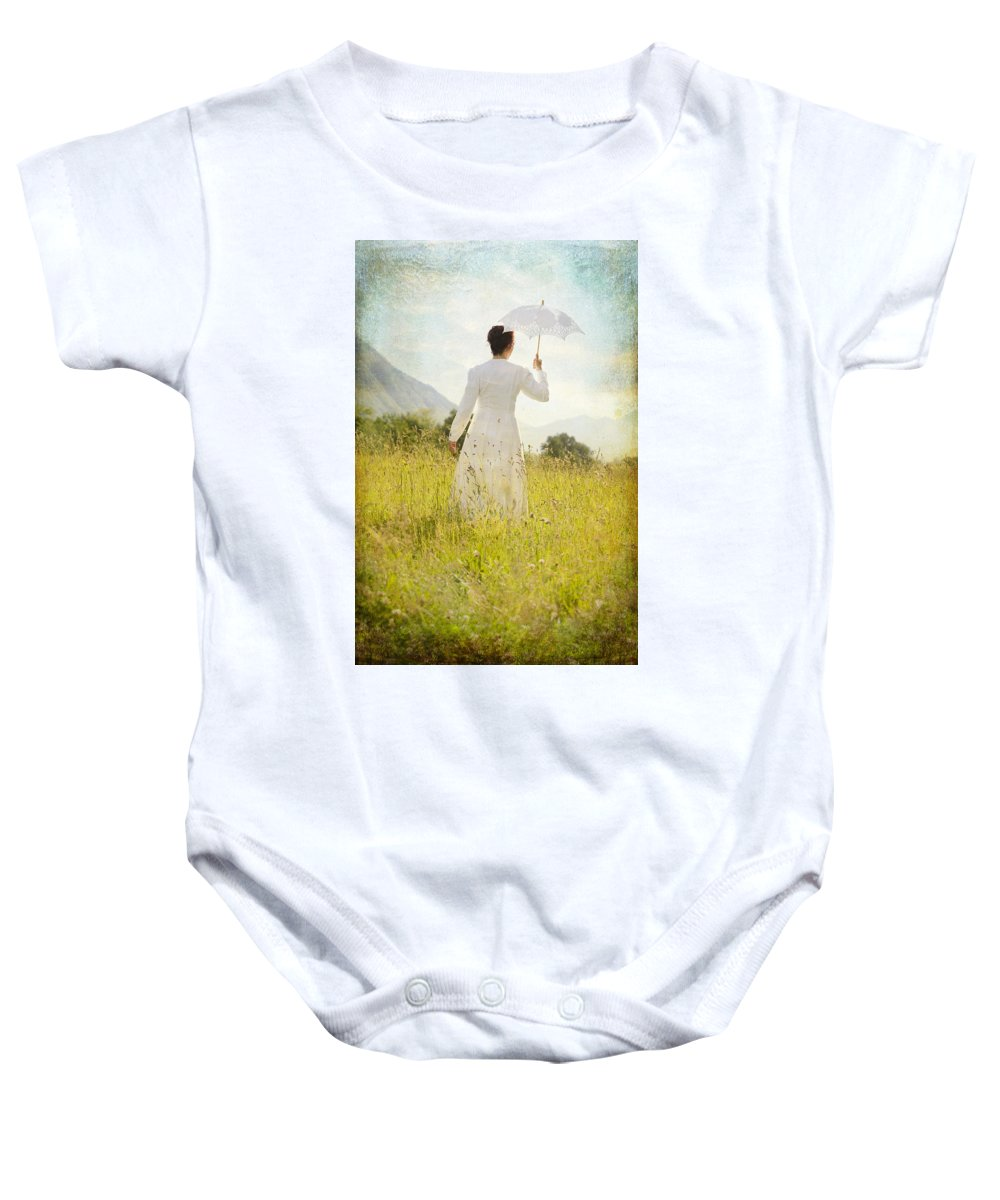 Female Baby Onesie featuring the photograph Walking On The Meadow by Joana Kruse