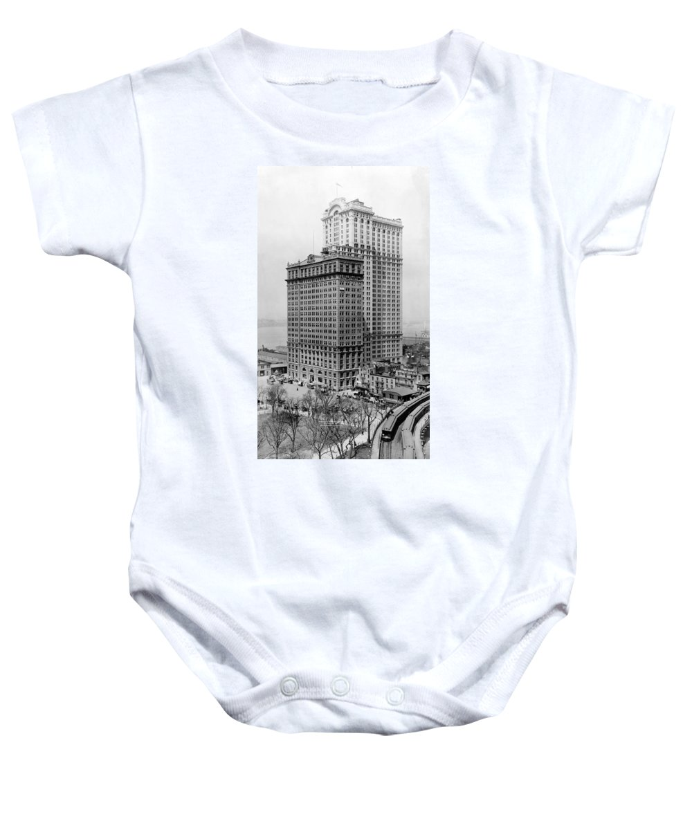whitehall Buildings Baby Onesie featuring the photograph Whitehall Buildings At Battery Place Station In New York City - 1911 by International Images