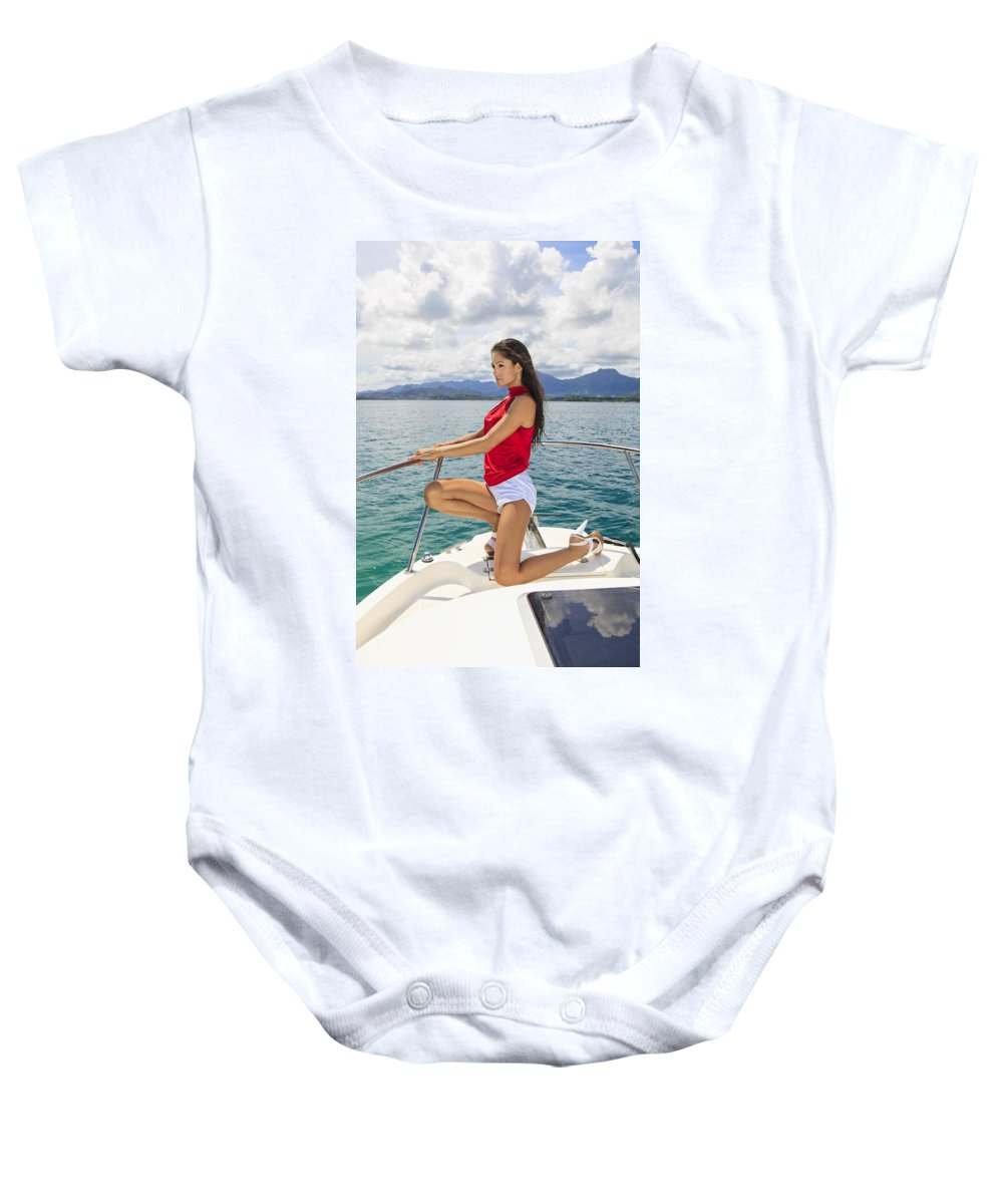 Attractive Baby Onesie featuring the photograph Woman At Kaneohe Bay by Tomas del Amo - Printscapes