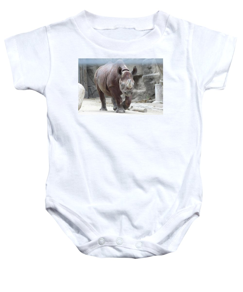 Baby Onesie featuring the photograph Rhino by Rocky Washington