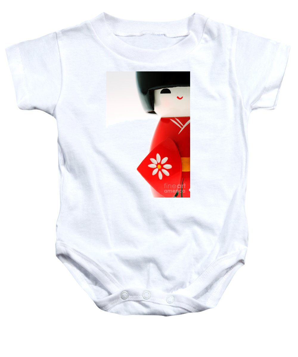Asian Cultural Art Baby Onesie featuring the photograph Kokeshi Doll by Larry Dale Gordon - Printscapes