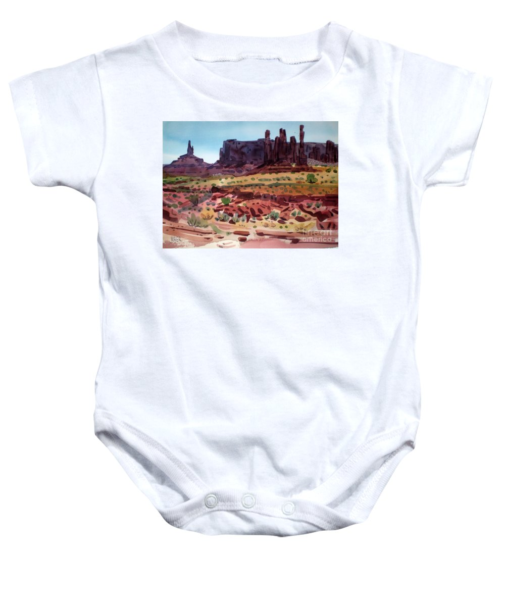 Monument Valley Baby Onesie featuring the painting Totem Poles by Donald Maier
