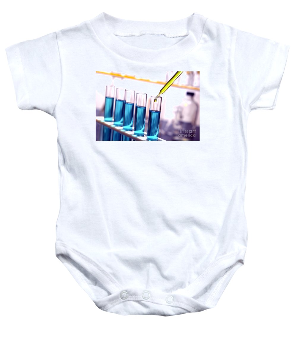 Blue Baby Onesie featuring the photograph Laboratory Test Tubes In Science Research Lab by Olivier Le Queinec