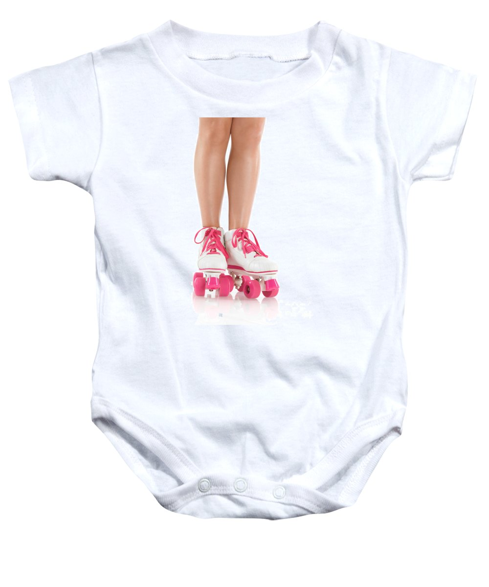 Roller Skates Baby Onesie featuring the photograph Young Woman Wearing Roller Derby Skates by Oleksiy Maksymenko