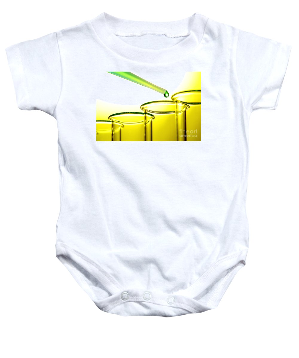 Above Baby Onesie featuring the photograph Laboratory Experiment In Science Research Lab by Olivier Le Queinec
