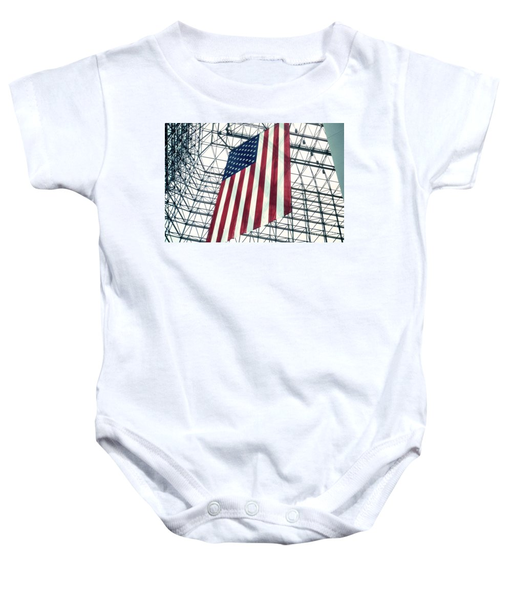 Flag Baby Onesie featuring the photograph American Flag In Kennedy Library Atrium - 1982 by Thomas Marchessault