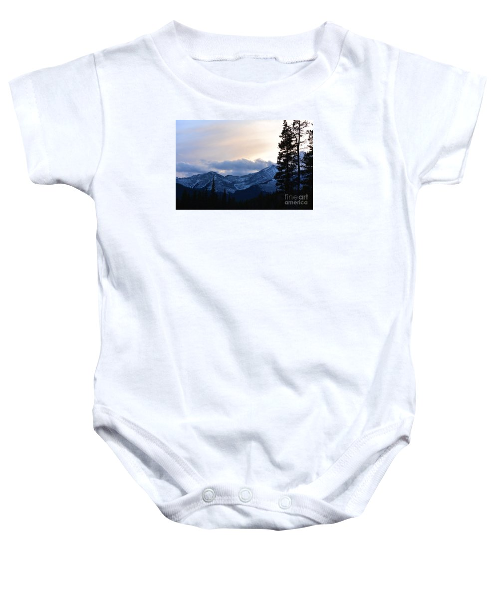 It's Just Before The First Heavy Snowfall. The Air Is Cool And Crisp As The Sun Goes Down At Dusk. There Is Only The Peaceful Silence And Solitude Of The Woods In The Blue Canadian Rockies. Baby Onesie featuring the photograph An Evening In The Mountains by V Oakes
