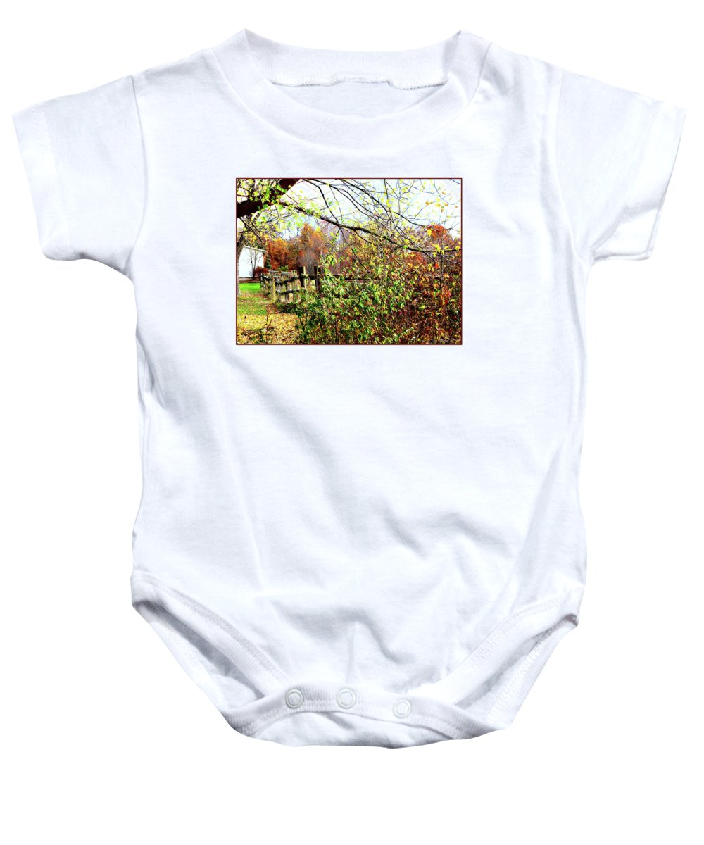 Fence Baby Onesie featuring the digital art Autumn Leaves Against A Fence by Joan Minchak