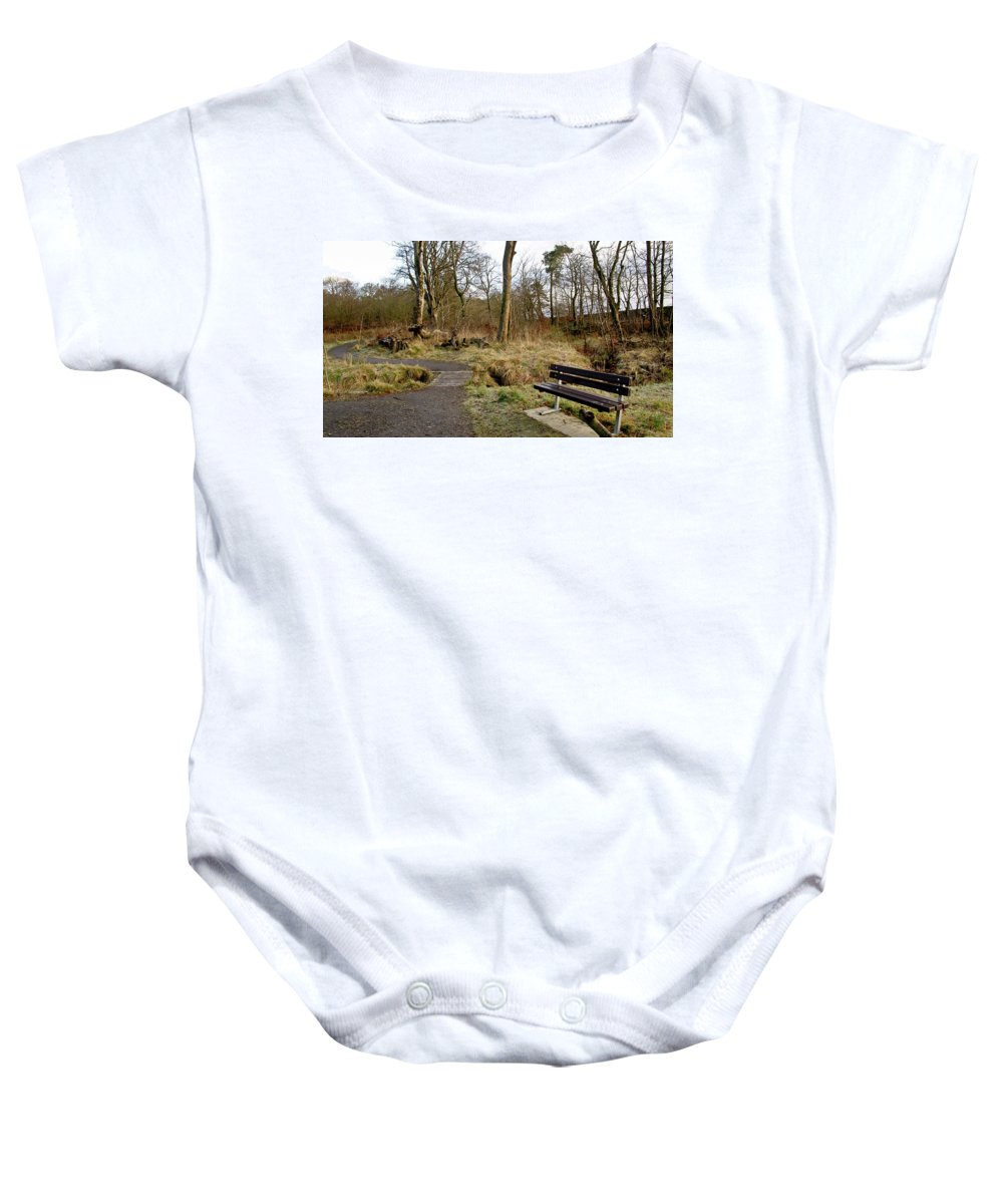 Bench Baby Onesie featuring the photograph Bench In Polkemmet Park. by Elena Perelman