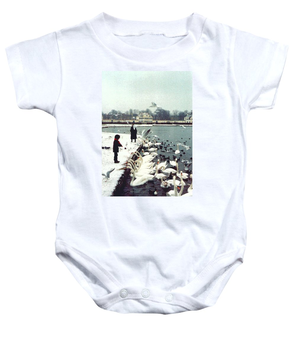 Swans Baby Onesie featuring the photograph Boy Feeding Swans- Germany by Nancy Mueller