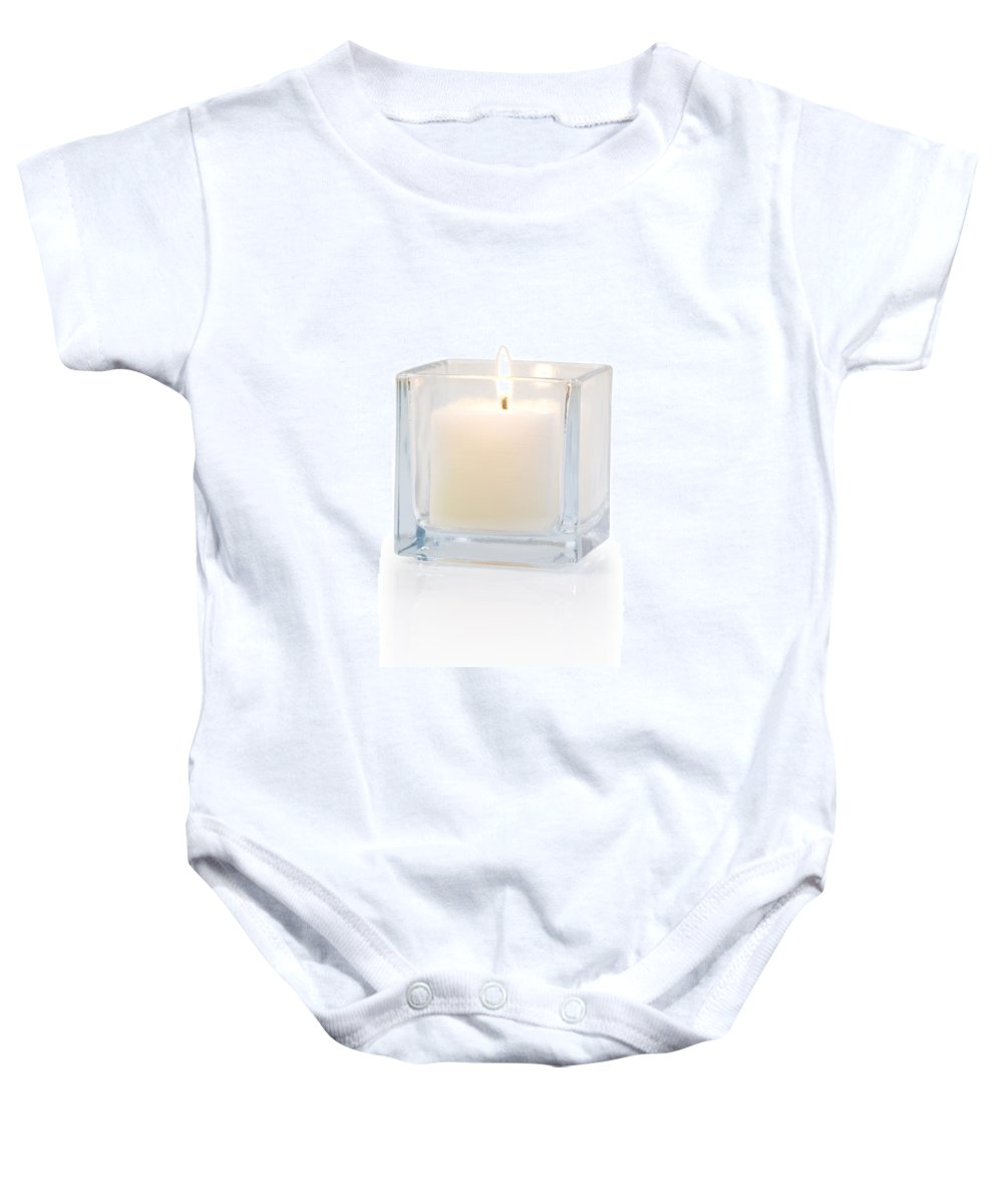Candle Baby Onesie featuring the photograph Burning Candle Side View 20 Degree by Atiketta Sangasaeng