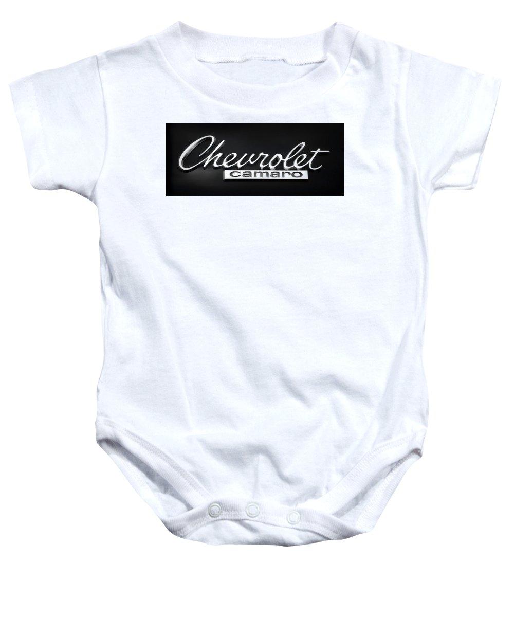 Chevrolet Camaro Baby Onesie featuring the photograph Chevy Camaro Emblem by Athena Mckinzie