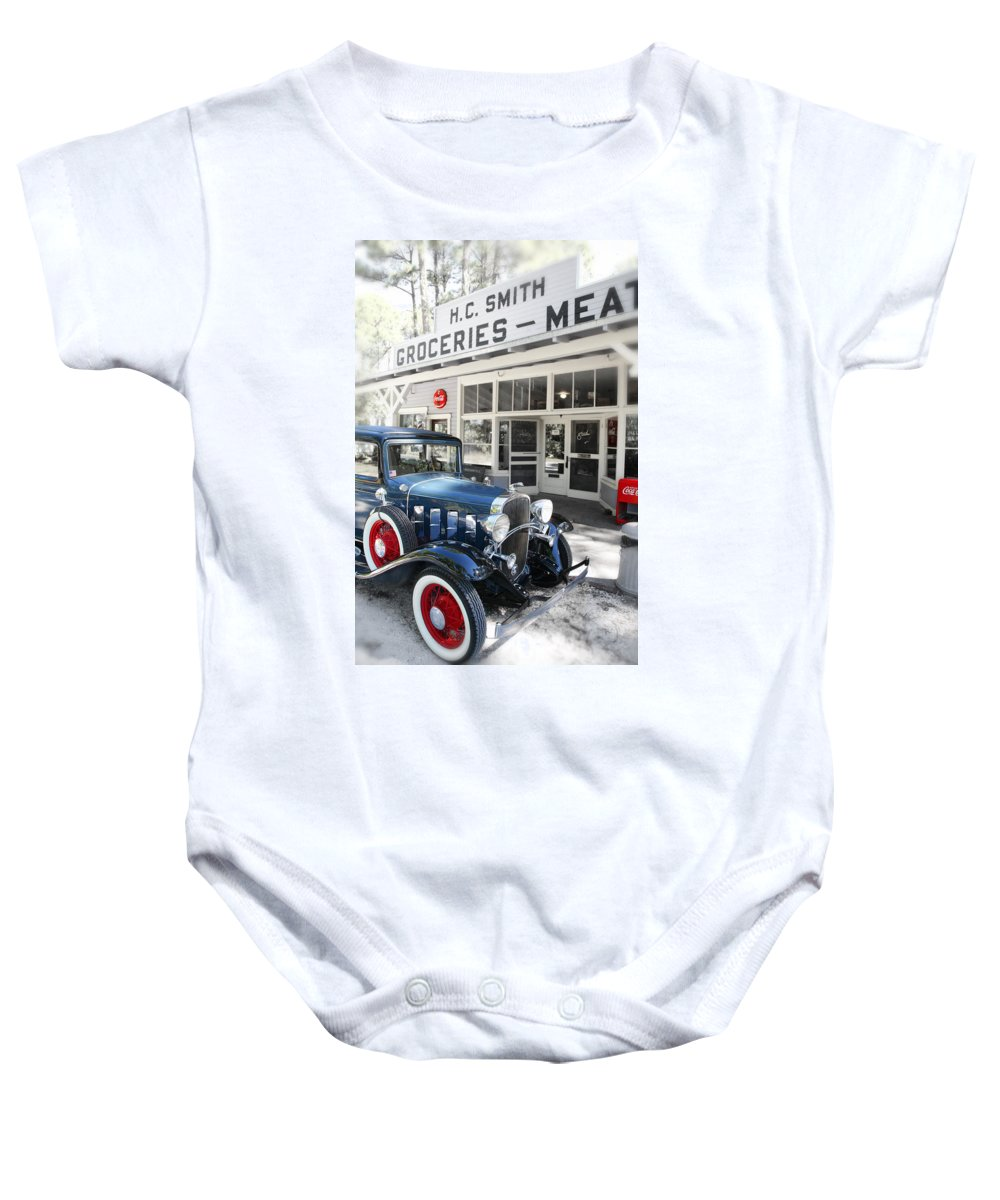 Chevy Baby Onesie featuring the photograph Classic Chevrolet Automobile Parked Outside The Store by Mal Bray