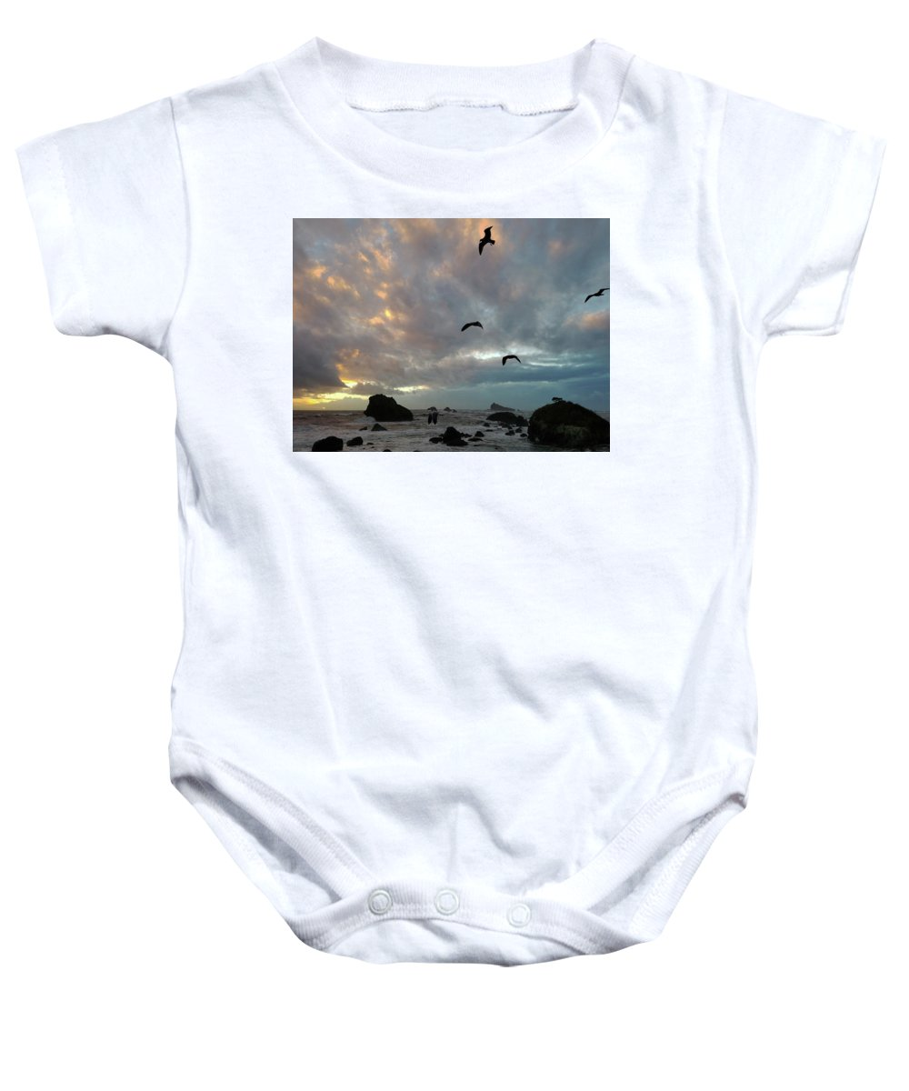 Beach Baby Onesie featuring the pyrography Color Burst Sunset by Karen Arnpriester