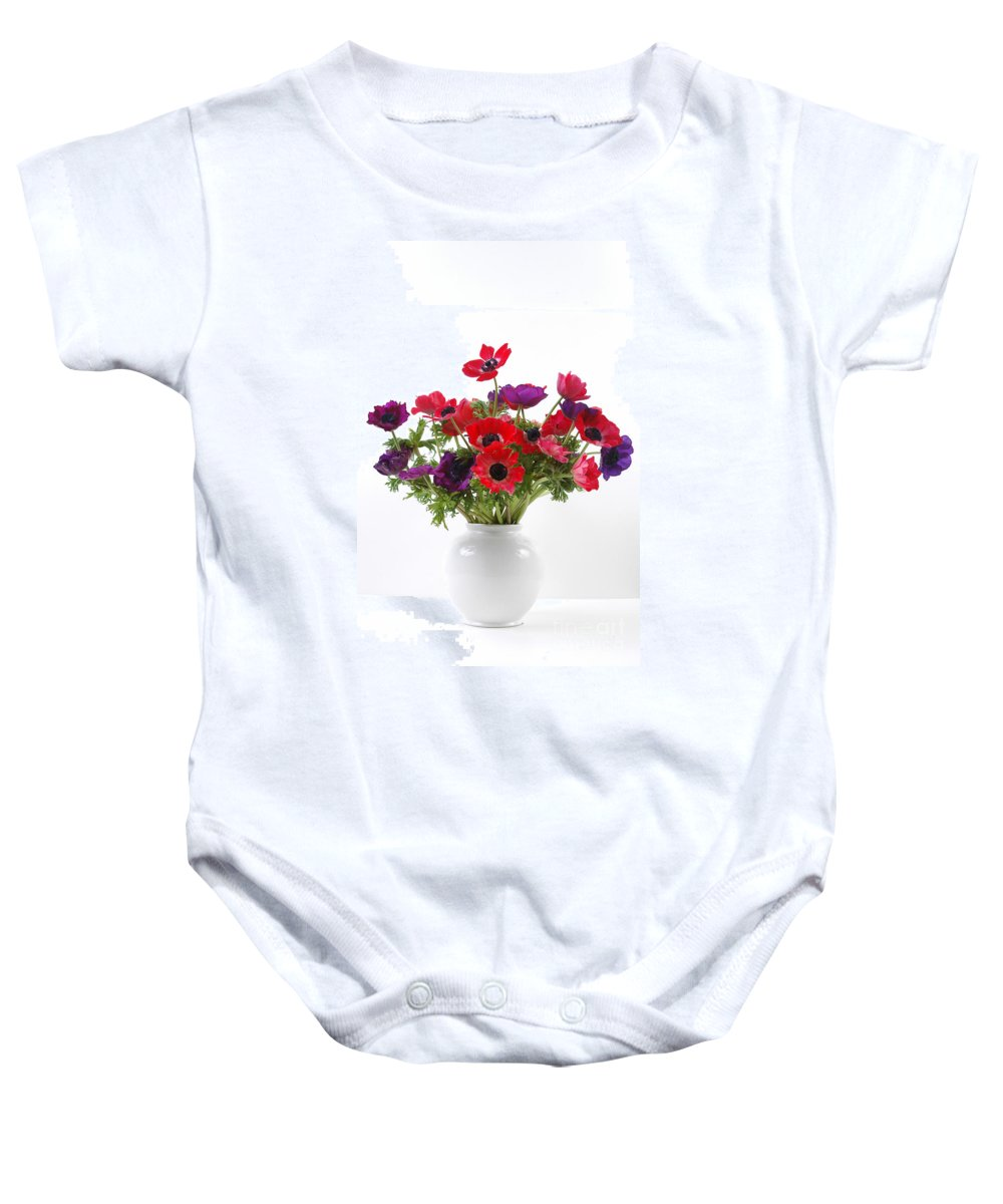 Flower Baby Onesie featuring the photograph crown Anemone in a white vase by Ilan Amihai