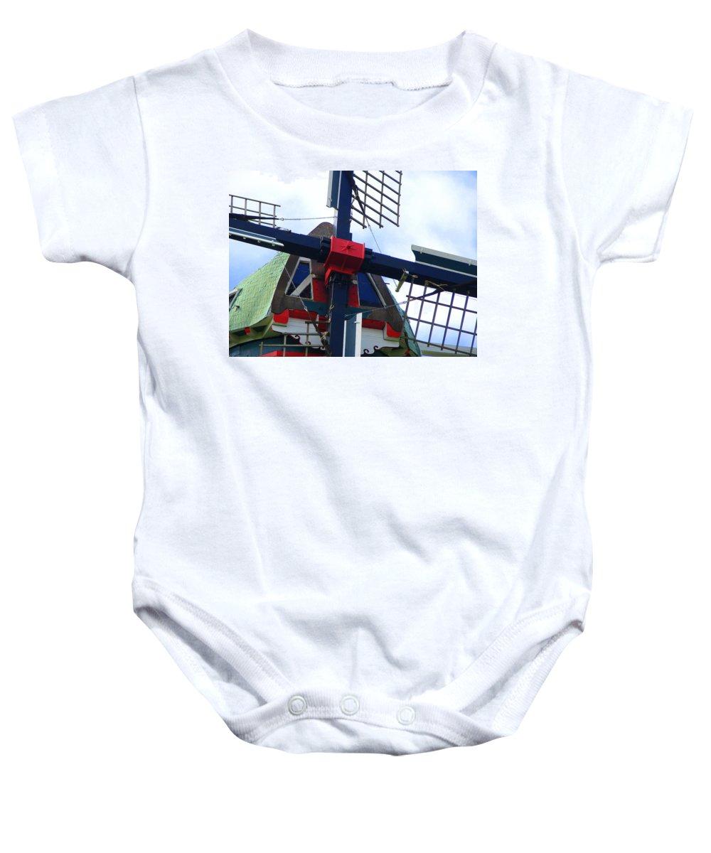 Dezwaan Baby Onesie featuring the photograph Dezwaan Windmill Holland Michigan by Michelle Calkins