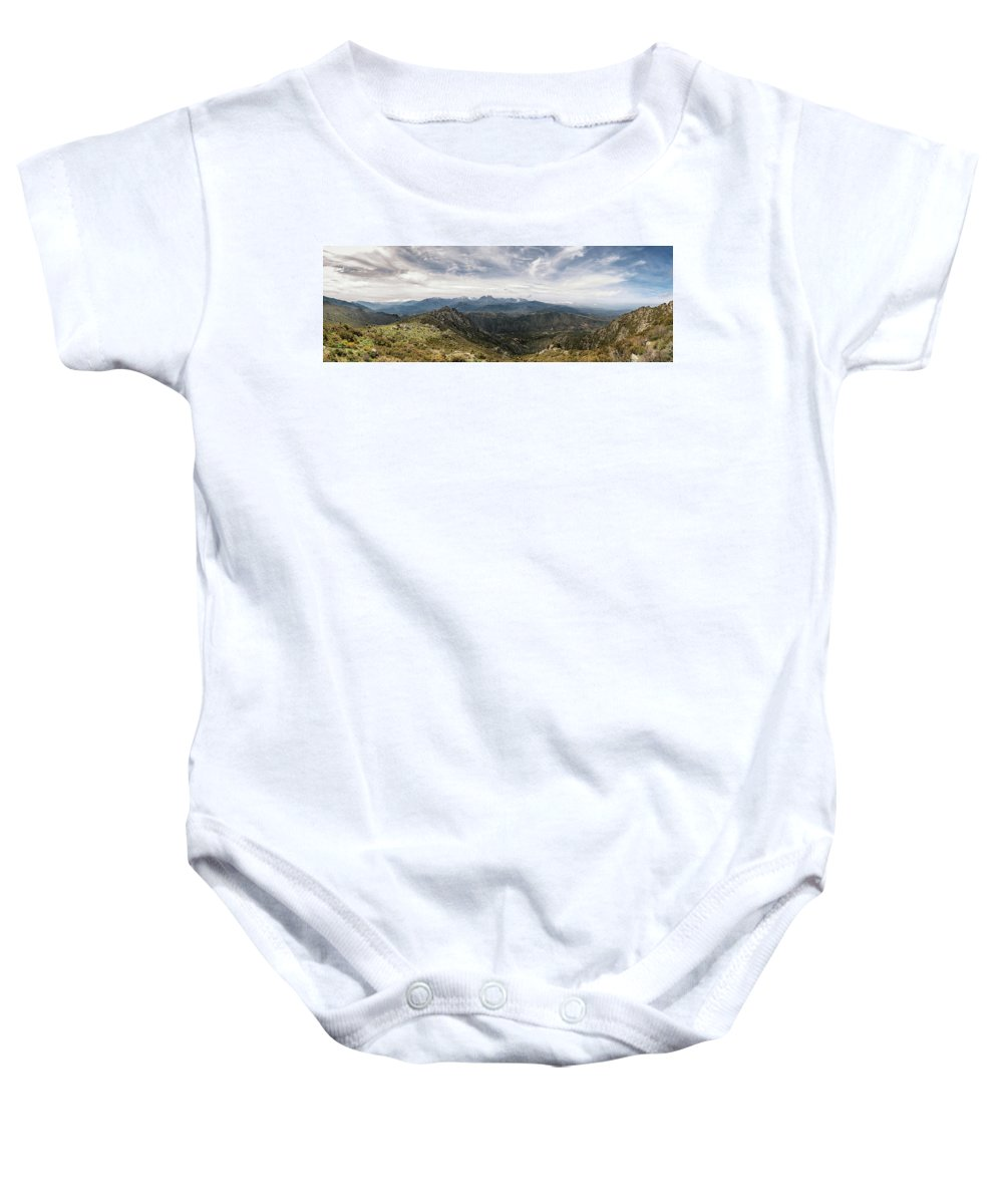 Astu Baby Onesie featuring the photograph Dramatic Panoramic View Of Snow Capped Mountains Of Northern Cor by Jon Ingall