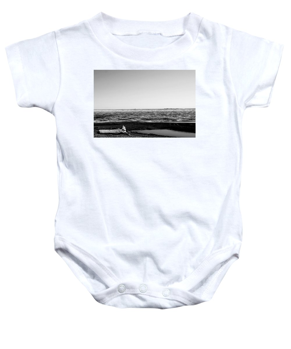 Landscape Baby Onesie featuring the photograph Driftwood On Arctic Beach Balck And White by Anthony Jones