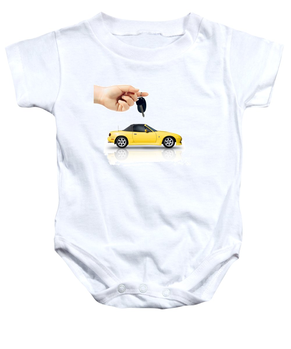 Car Baby Onesie featuring the photograph Hand Holding Key To Yellow Sports Car by Jorgo Photography - Wall Art Gallery