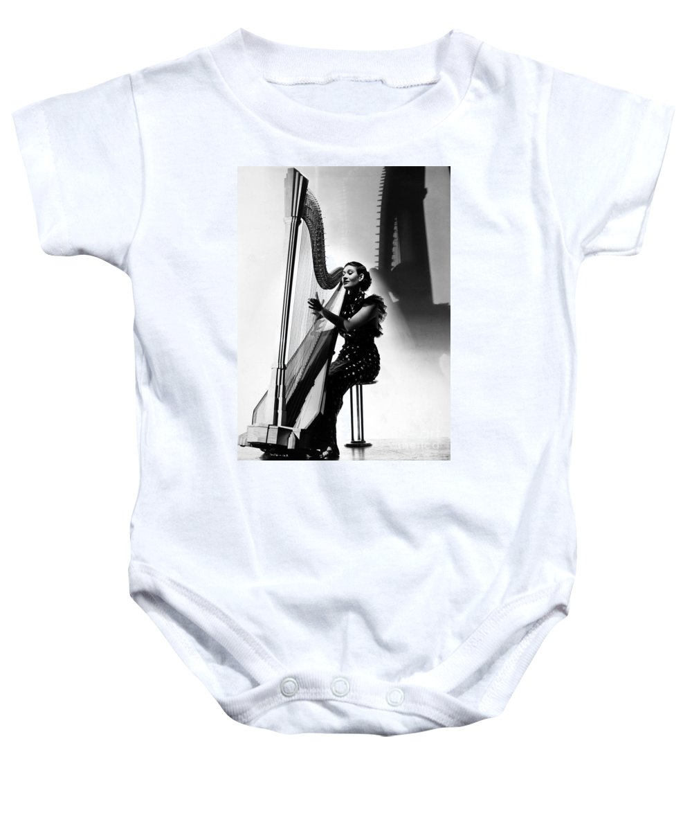 1935 Baby Onesie featuring the photograph Harpist, 1935 by Granger