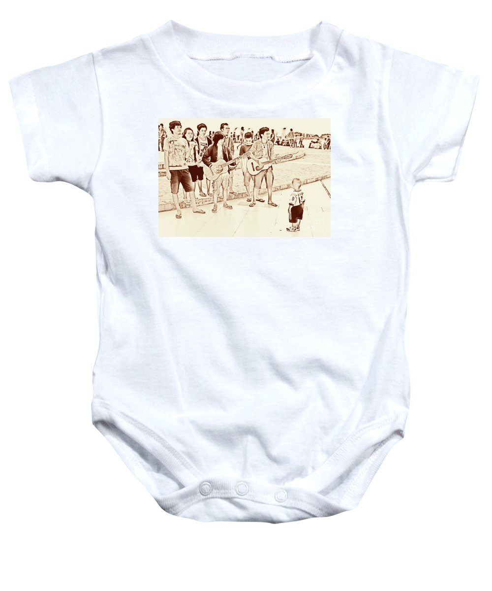 Boys Baby Onesie featuring the photograph Hey Baby We Sing For You by Charuhas Images