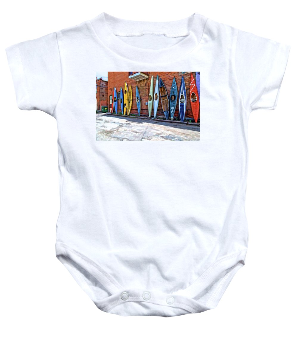 Kayak Baby Onesie featuring the photograph Kayaks On A Wall by Charles Muhle