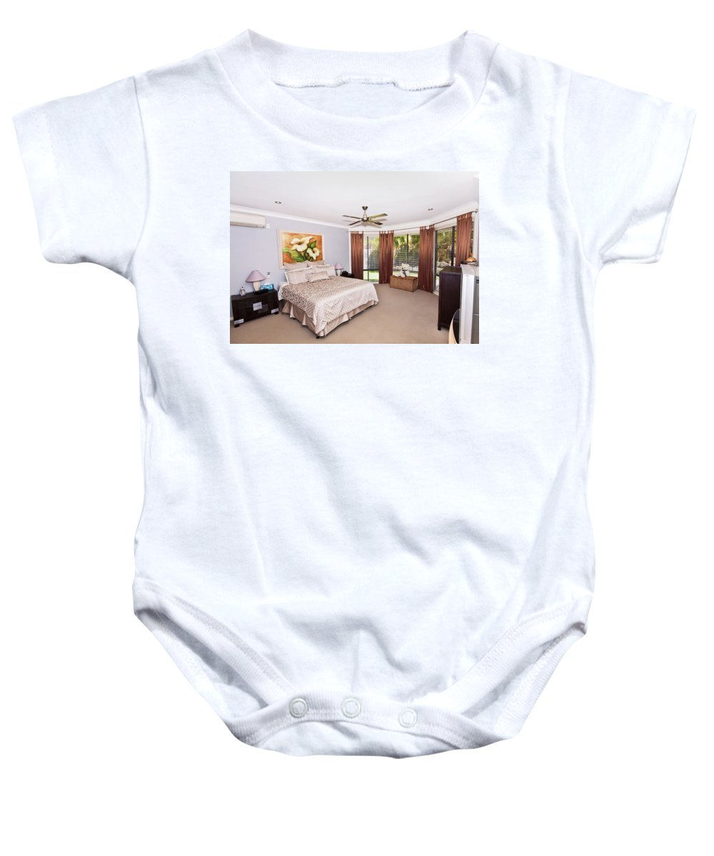 Large Baby Onesie featuring the photograph Large Bedroom by Darren Burton
