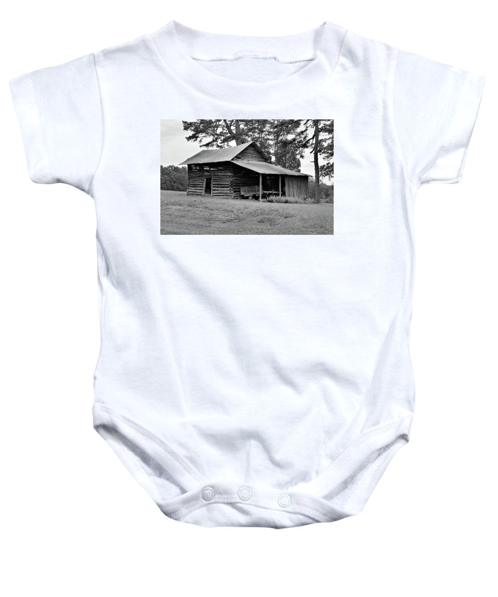 Pilot Mountain Baby Onesie featuring the photograph Log Shed by Tony Hill